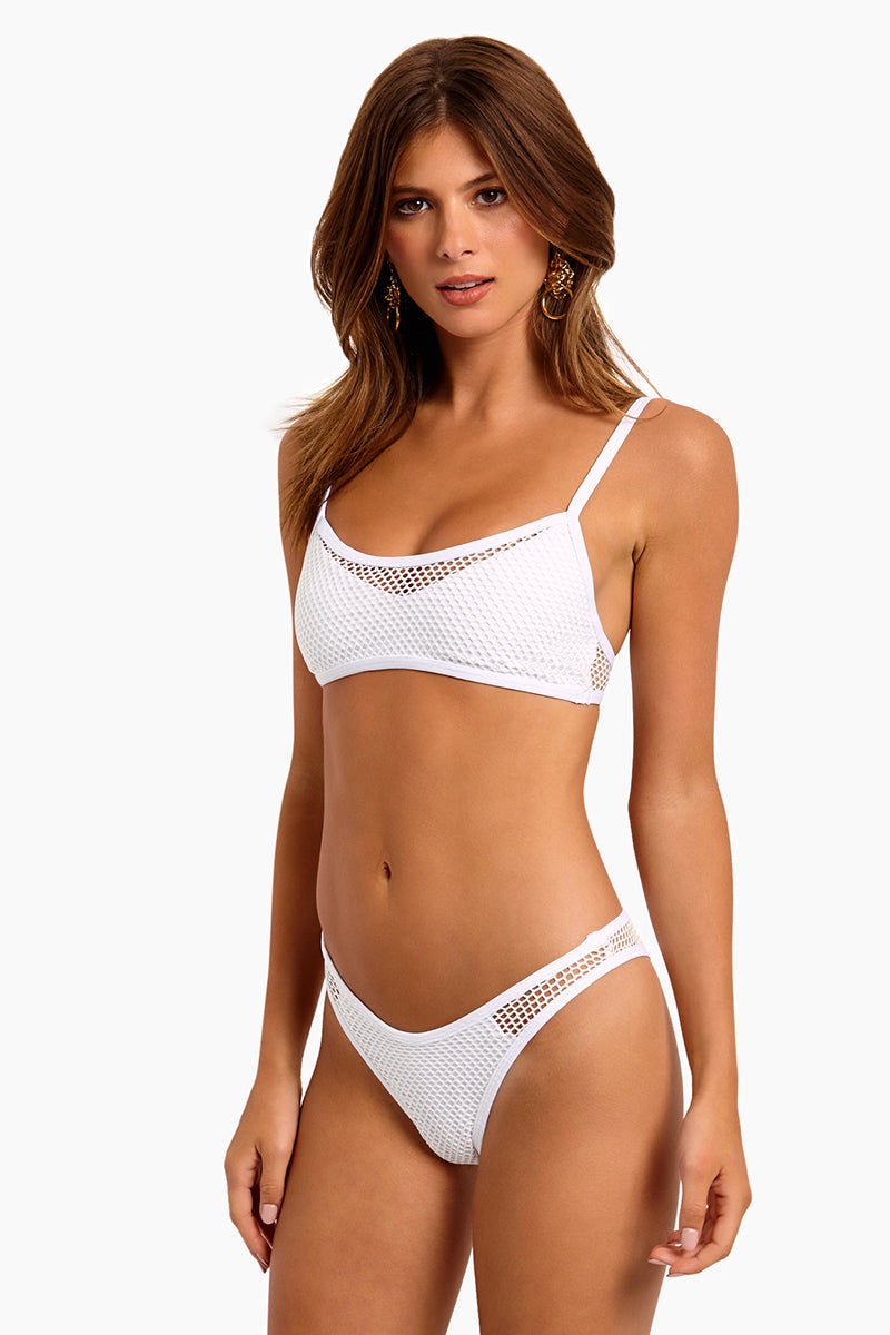 L SPACE Stevie Mesh Cheeky Bikini Bottom - White Bikini Bottom | White|L SPACE Stevie Mesh Cheeky Bikini Bottom - White.  Features:  High-cut leg Mesh overlay throughout Cheeky coverage Side cut out with mesh overlay Low rise Side View