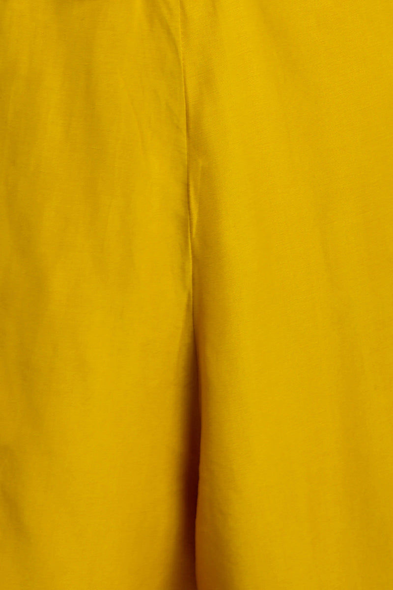 MOTEL Roman Loose Cut Out Romper - Mustard Romper | Mustard| Motel Roman Loose Cut Out Romper - Features: Romper Plunge neckline Opal cutout Tie knot detailing Zipper closure Loose shorts Close Up View