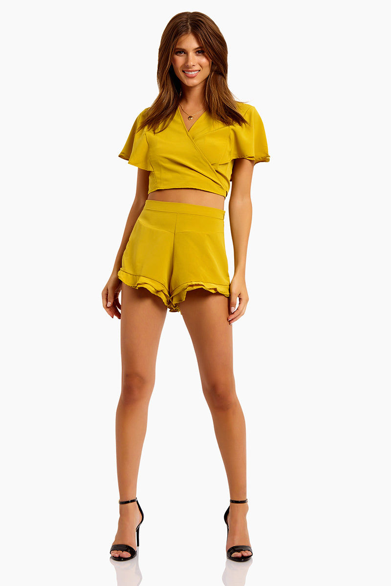 MOTEL Gios V Neck Crop Top - Mustard Top | Mustard| Motel Gios V Neck Crop Top:  Features:  V Neckline Wrap style Tie up detail  Floaty short sleeves Cropped length in mustard yellow Front View