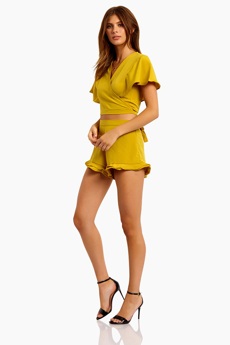 MOTEL Gios V Neck Crop Top - Mustard Top | Mustard| Motel Gios V Neck Crop Top:  Features:  V Neckline Wrap style Tie up detail  Floaty short sleeves Cropped length in mustard yellow Side View