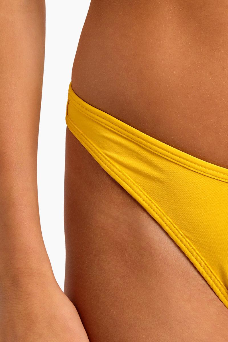 L SPACE Whiplash High Cut Bikini Bottom - Sunshine Gold Bikini Bottom | Sunshine Gold| L Space Whiplash High Cut Bikini Bottom - Sunshine Gold High-cut leg Bitsy coverage Made in the USA Close Up View