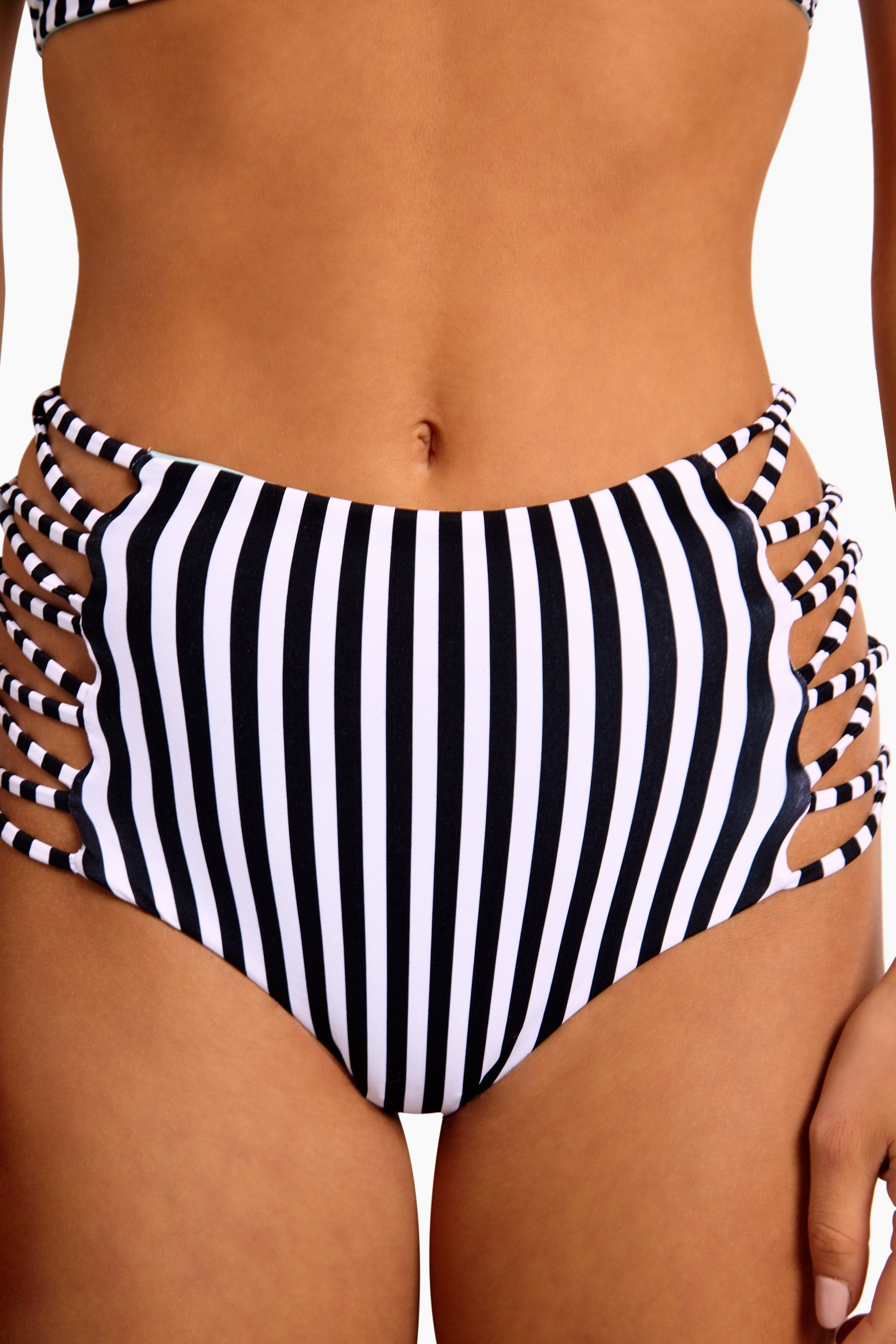 L SPACE Tripp Strappy High Waist Bikini Bottom - Domino Stripe Bikini Bottom | Domino Stripe| L Space Tripp Strappy High Waist Bikini Bottom - Domino Stripe High-waist bikini bottom Interlocking strappy detail along hips Bitsy coverage Close Up View