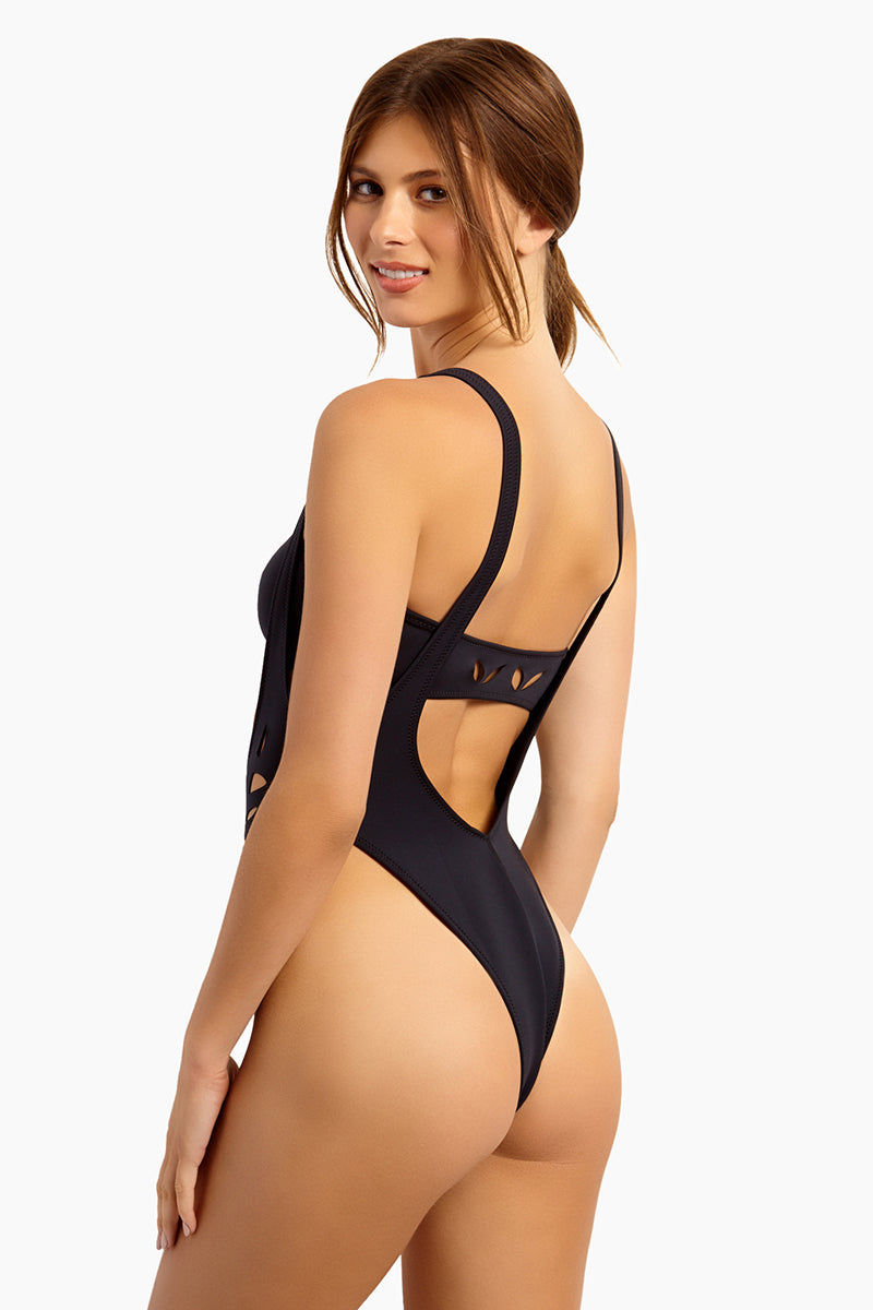 GIGI C Amanda Suspender One Piece Swimsuit - Black One Piece | Black| GIG C Amanda One Piece Swimsuit - Black. Model is wearing size small Silky, thin scuba Flat lock seaming hugs your curves and creates a silky smooth interior, ensuring ultimate comfort Centerfront locking zipper Adjustable straps Cutout design featuring lasercut technology for bold graphic shapes Medium to minimal cheek coverage 84% Polyester 16% Spandex