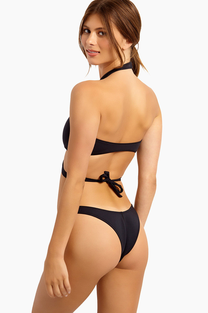 GIGI C Brienna Cross Front Bikini Top - Black Bikini Top   Black  GIGI C Brienna Bikini Top - Black. Features: Model is wearing size small Silky, thin scuba Flat lock seaming hugs your curves and creates a silky smooth interior, ensuring ultimate comfort Cutout design featuring lasercut technology for bold graphic shapes Adjustable enamel swan hook closure at neck, tie closure at back 84% Polyester 16% Spandex