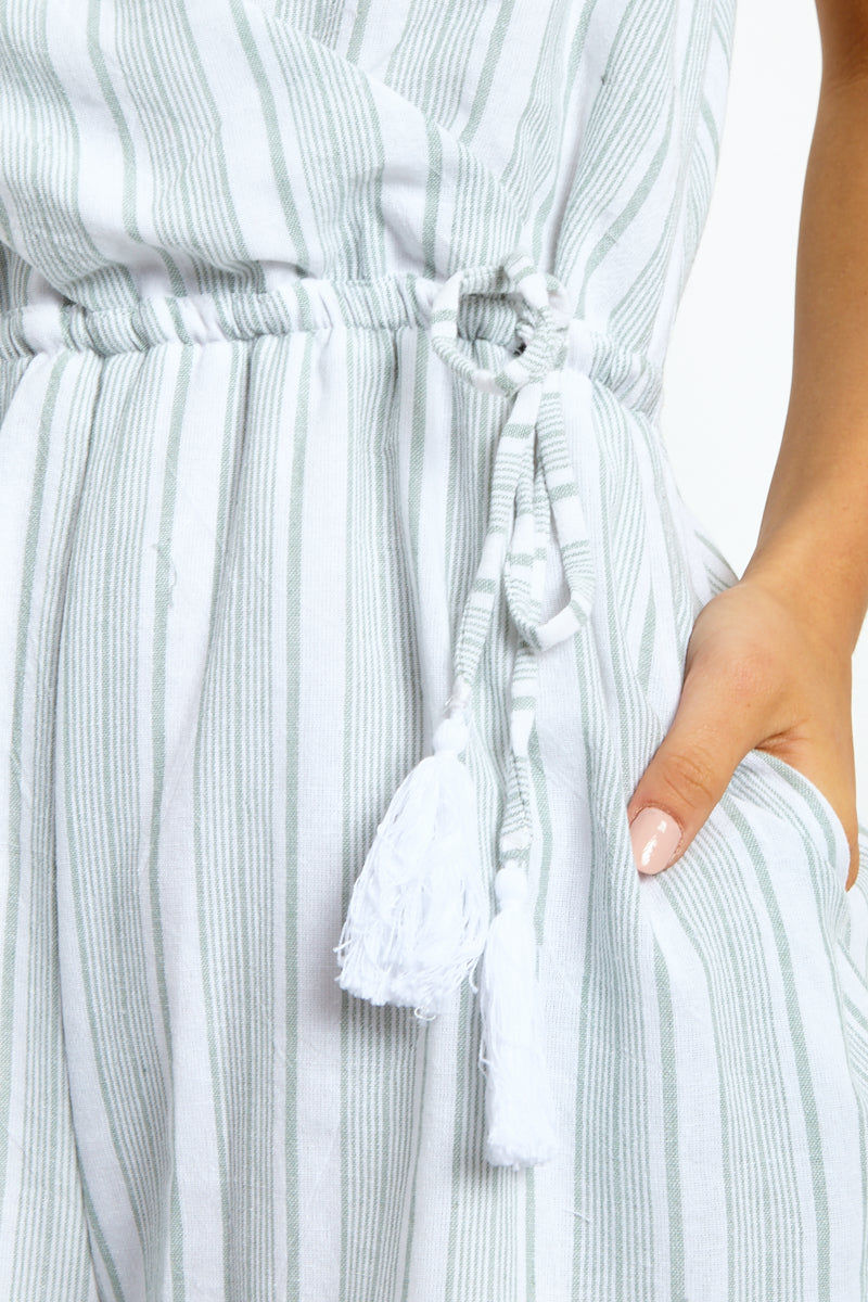 MINKPINK Sage Stripe Playsuit - Sage/White Romper | Sage/White| MinkPink Sage Stripe Playsuit - Sage/White V Neckline  Tie Side Closure  Tassel Ends of Strings  Adjustable Shoulder Straps Ruffle Trim at Bottom  Close Up View
