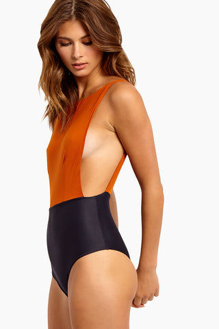 HAIGHT Side Slit Maillot One Piece Swimsuit - Rust & Black One Piece | Rust & Black| Haight Side Slit Maillot One Piece Swimsuit - Rust & Black Features: Crew Neck One Piece Deep sides Detail Scoop Back Thick Back Straps Low Cut Leg Moderate Coverage  Side View