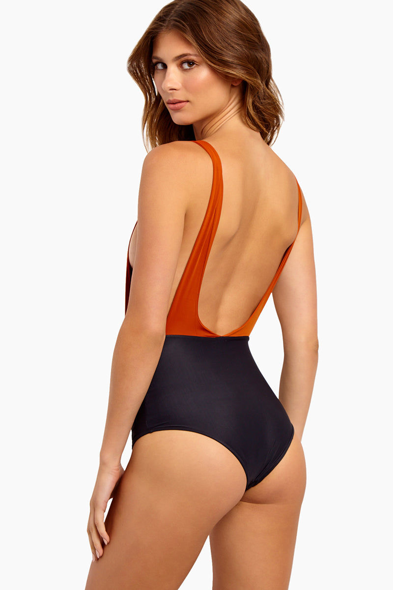 HAIGHT Side Slit Maillot One Piece Swimsuit - Rust & Black One Piece | Rust & Black| Haight Side Slit Maillot One Piece Swimsuit - Rust & Black Features: Crew Neck One Piece Deep sides Detail Scoop Back Thick Back Straps Low Cut Leg Moderate Coverage  Back View