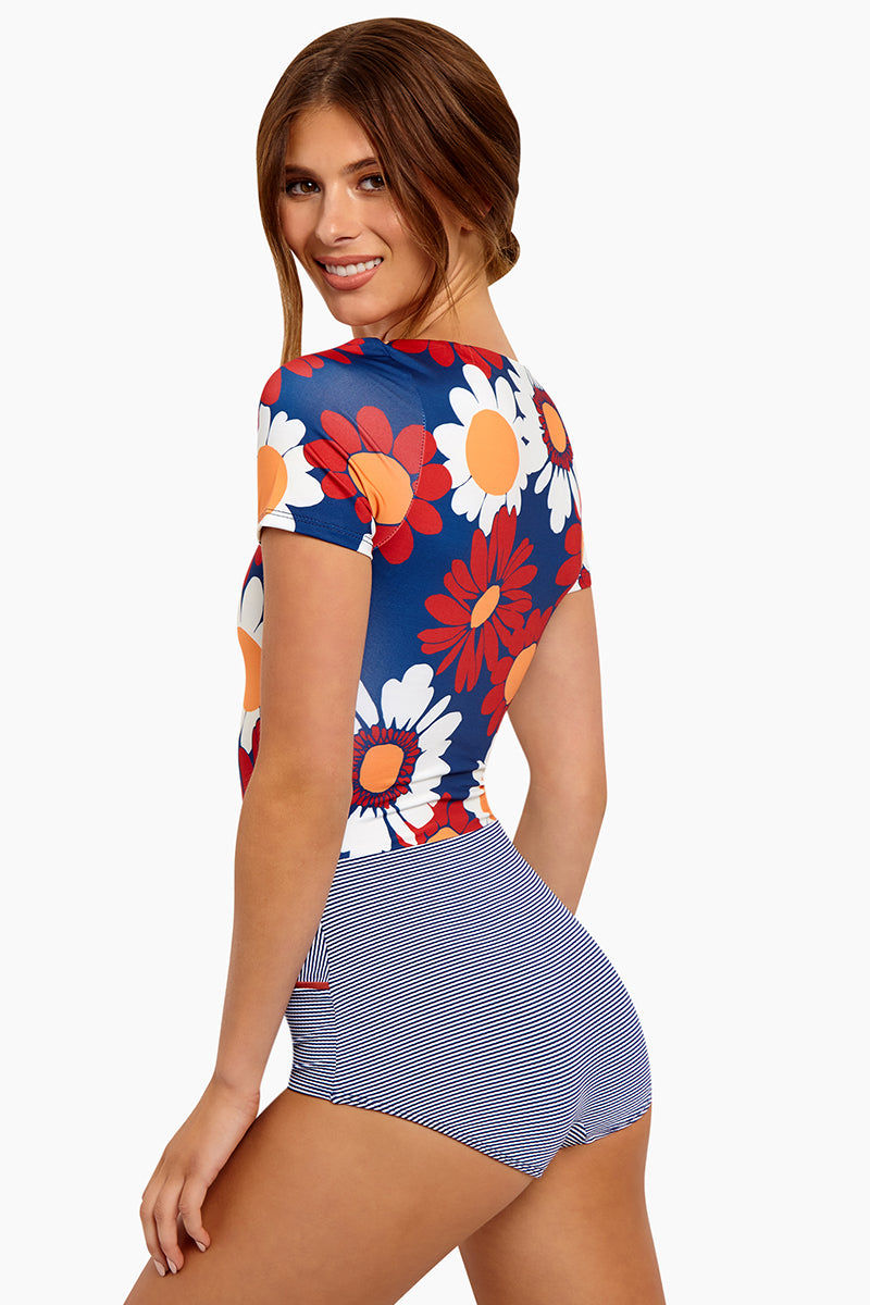 SEEA Kiki Short Sleeve Color Blocked One Piece Swimsuit - Marguerite Print One Piece | Marguerite| Seea Kiki Short Sleeve One Piece Swimsuit - Features: Scoop neckline  clean finish lining in the armholes to prevent chafing Textured retro cut bottom gives modest coverage Color block detail shows off a flattering waistline Made in the USA Back View