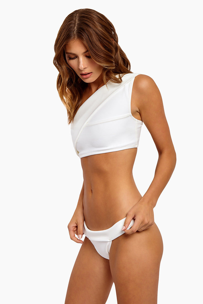 HAIGHT Maria One Shoulder Bikini Top - Off-White Bikini Top | Off-White |Haight Maria One Shoulder Bikini Top - Off-White Features:  One Shoulder style Full coverage bikini top Wide band and straps Pull over style Side View