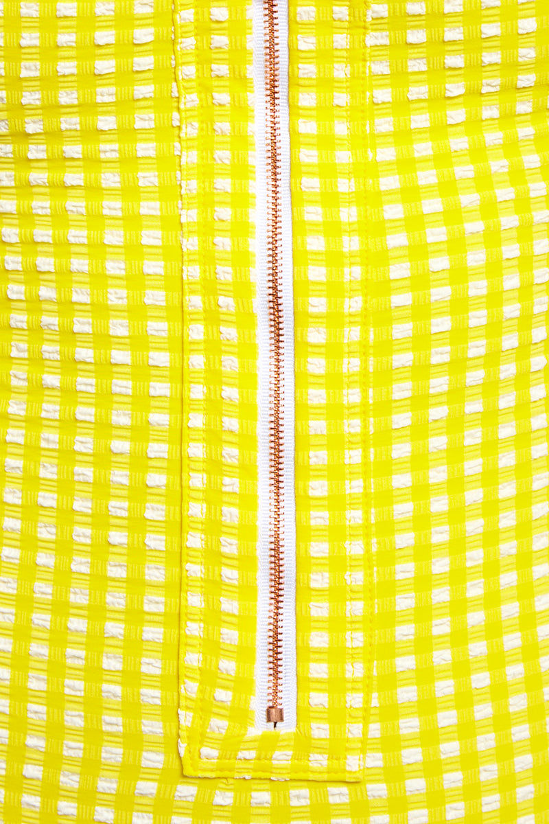 BLUE LIFE Zipped Up One Piece Swimsuit - Yellow Seersucker One Piece | Yellow Seersucker| Blue Life Zipped Up One Piece Swimsuit - Yellow Seersucker Front Zipper Closure  Criss Cross Back Straps  Lace Up Back Detail  High Cut Leg Cheeky Coverage  Gingham Print  Textured Fabric Made in USA Hand Wash Spandex Nylon Blend Close Up View