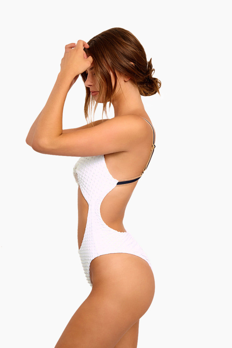 BLUE LIFE Cruise Twist Front One Piece Swimsuit - White Seersucker One Piece | White Seersucker| Blue Life Cruise Twist Front One Piece Swimsuit - White Seersucker  Twist Front Bust Detail Front Cut Out Detail Contrasting Adjustable Shoulder Straps  Back Hook Closure Open Back High Cut Leg Ruched Back  Cheeky Coverage Textured Spandex Fabrication Made in USA Hand Wash Spandex Nylon Blend  Side View