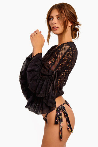 WE ARE HAH Kim-On-Hoe Lace Wrap Blouse - Noir Top | Noir| Hot As Hell Kim-On-Hoe Top - Noir Wrap Blouse Top Deep V Neckline  Front Tie Closure Bell Sleeves  Side Ties On The Sleeves For Adjustability  Lace Detailing Along The Arms  Ruffle Detail Side View