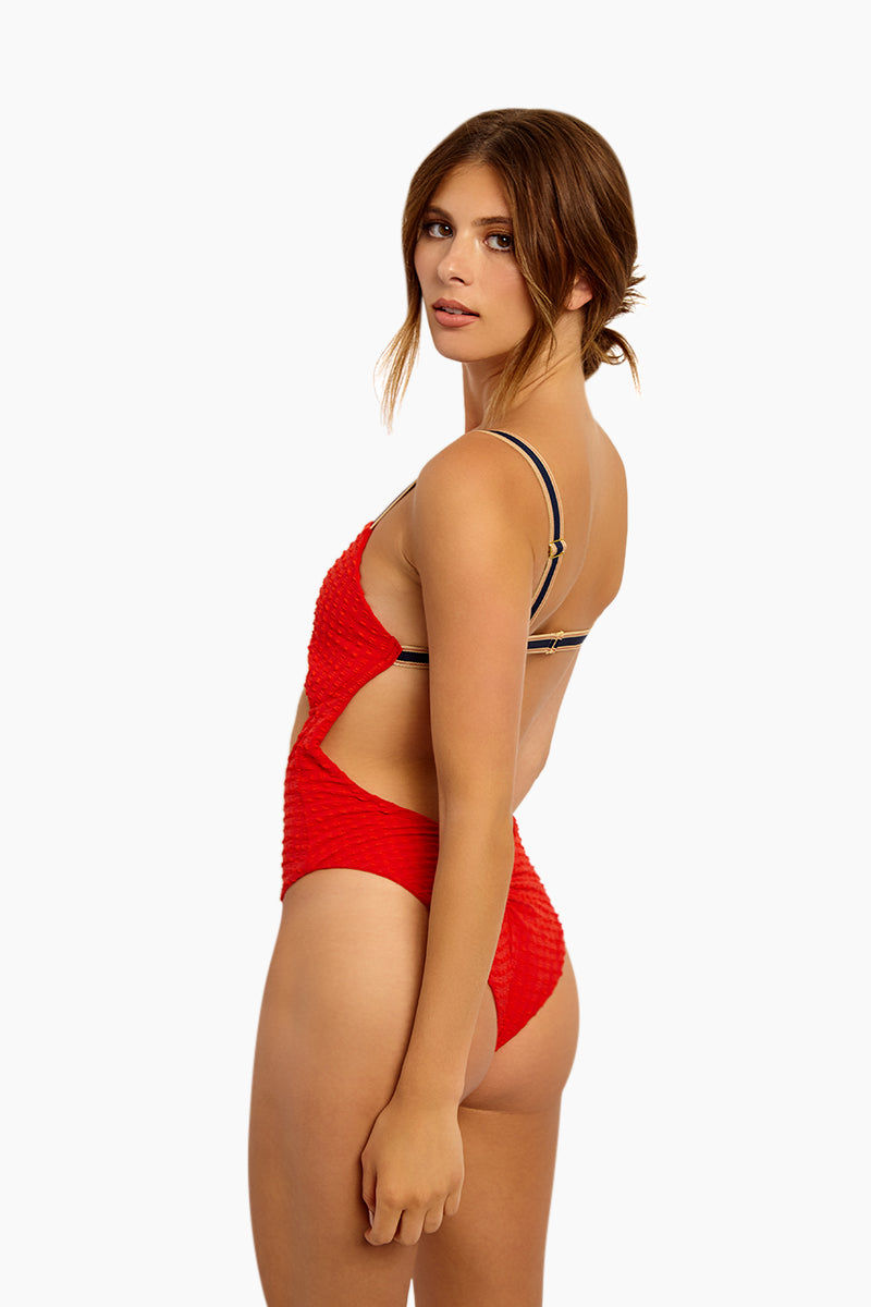 BLUE LIFE Cruise Twist Front One Piece Swimsuit - Red Seersucker One Piece | Red Seersucker| Blue Life Cruise Twist Front One Piece Swimsuit - Red Seersucker Twist Front Bust Detail Front Cut Out Detail Contrasting Adjustable Shoulder Straps  Back Hook Closure Open Back High Cut Leg Ruched Back  Cheeky Coverage Textured Spandex Fabrication Made in USA Hand Wash Spandex Nylon Blend Side View
