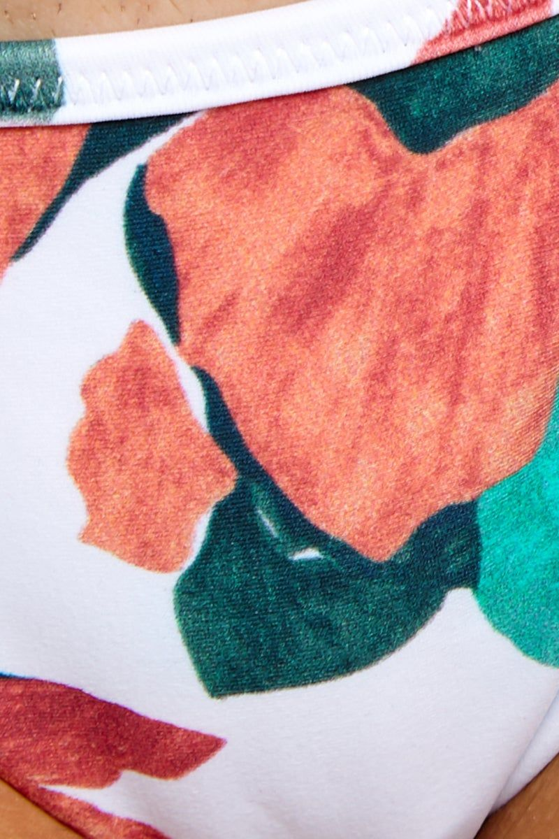 VIX SWIMWEAR Bluebell Ruffle Tri Bikini Top - Bluebell Bikini Top | Bluebell | Vix Swimwear Bluebell Ruffle Tri Bikini Top -Bluebell Features - Bluebell Close Up View Ruffle Strap Detailing Front Tie Closure Removable Cups LYCRA blend Made in Brazil Tropical Print Bikini Top