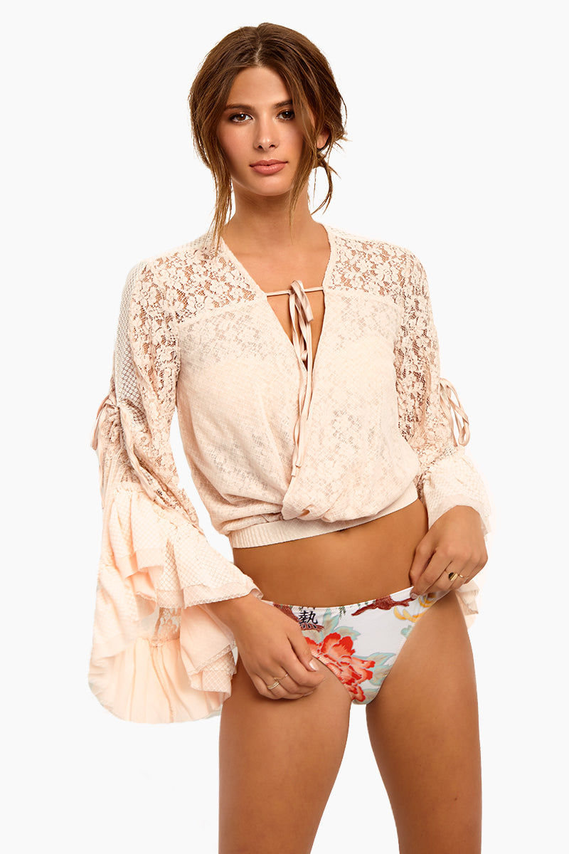 WE ARE HAH Kim-On-Hoe Lace Wrap Blouse - Au Naturale Top | Au Naturale| Hot As Hell Kim-On-Hoe Top - Au Naturale Wrap Blouse Top Deep V Neckline  Front Tie Closure Bell Sleeves  Side Ties On The Sleeves For Adjustability  Lace Detailing Along The Arms  Ruffle Detail Front View