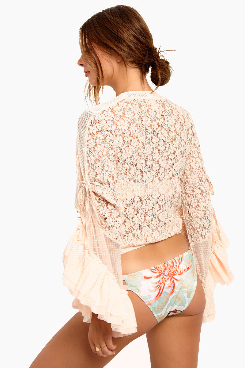 WE ARE HAH Kim-On-Hoe Lace Wrap Blouse - Au Naturale Top | Au Naturale| Hot As Hell Kim-On-Hoe Top - Au Naturale Wrap Blouse Top Deep V Neckline  Front Tie Closure Bell Sleeves  Side Ties On The Sleeves For Adjustability  Lace Detailing Along The Arms  Ruffle Detail Back View