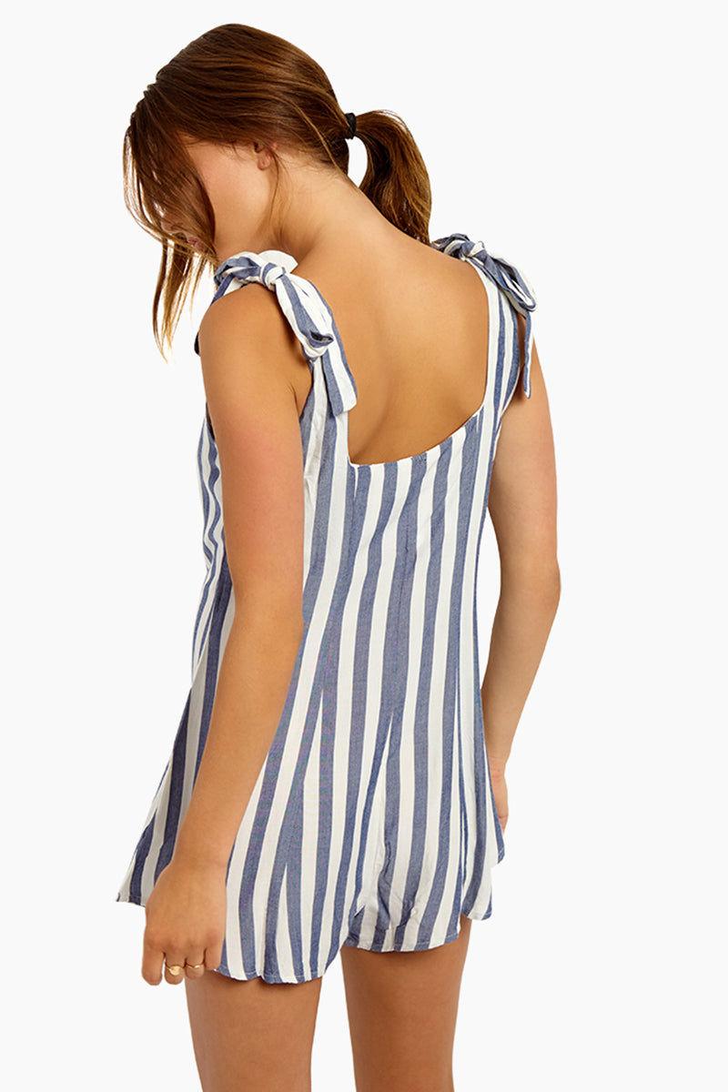 BEACH RIOT Zoey Shoulder Tie Romper - Blue/White Stripe Romper | Blue/White Stripe| Beach Riot Zoey Shoulder Tie Romper - Blue/White Stripe Straight Neckline  Front Button Detail Shoulder Ties Straps  Scoop Back  Blue & White Vertical Stripe Print Back View