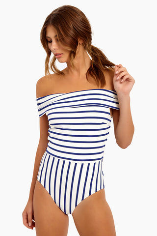 SOLID & STRIPED The Vera Off Shoulder One Piece Swimsuit - Navy Breton One Piece | Navy Breton| Solid & Striped The Vera Off Shoulder One Piece Swimsuit - Navy Breton. FEATURES:  Off-Shoulder One Piece Swimsuit Moderate coverage Made in Morocco Shell: 80% Polyester, 20% Elastane Lining: 8% Polyamide, 15% Elastane   CARE:   Hand wash in cold water, do not tumble dry. Front View