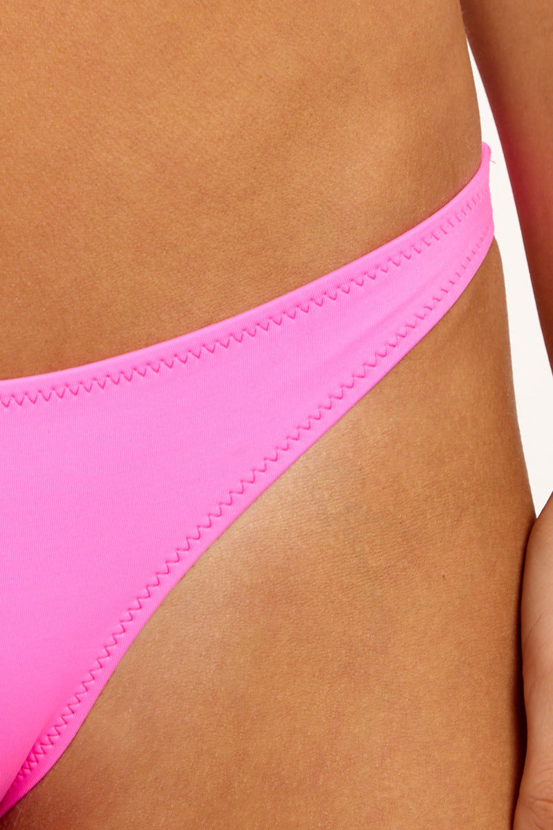SOLID & STRIPED The Rachel Low Rise Bikini Bottom - Malibu Pink Bikini Bottom | Malibu Pink| Solid & Striped The Rachel Low Rise Bikini Bottom - Malibu Pink Low-Rise Bottom Thin Side Straps Cheeky Coverage Close Up View