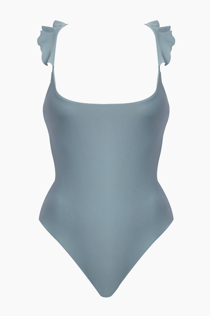 GILLIA Lillian Ruffle One Piece Swimsuit - Steel One Piece | Steel| GILLIA Lilian Ruffle One Piece Swimsuit - Steel Scoop Neckline  Ruffle Shoulder Detail  Adjustable Back Ties High Cut Leg  Moderate Coverage  80% Nylon / 20% Spandex Made in Indonesia Flatlay View
