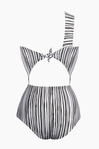 GILLIA Bruna One Shoulder One Piece Swimsuit - Monochrome One Piece | Monochrome| GILLIA Bruna One Shoulder One Piece Swimsuit - Monochrome One shoulder strap detail Front cutout Back tie detail High waist bottom Moderate coverage 80% Nylon / 20% Spandex Made in Indonesia Back Flatlay View