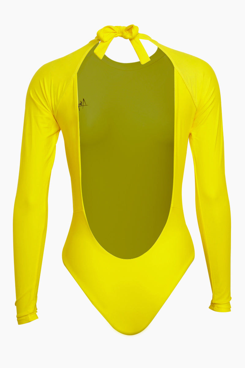 ABYSSE Billie Long Sleeve One Piece Swimsuit - Yellow One Piece | Yellow| Abysse Billie Long Sleeve One Piece Swimsuit - Yellow Features:  High neck Bow Tie Neck Closure Open Back High waisted  2 inch elastic support Dry Fast and UV protective Made in California out of 100% Italian Recycled Fabric (given new life through recycling fishing nets) Back View