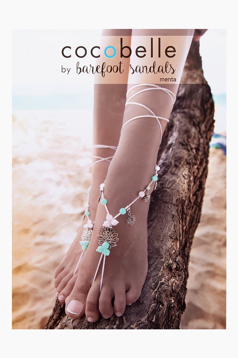 COCOBELLE Barefoot Sandals - Menta Jewelry | Menta| Cocobelle Barefoot Sandals - Menta. Features:  Beautiful blue and white beads with Lotus flower charm Chic barefoot sandals Look great at poolside, yoga class, beach wedding Barefoot or paired with other shoes One size fits all Front View
