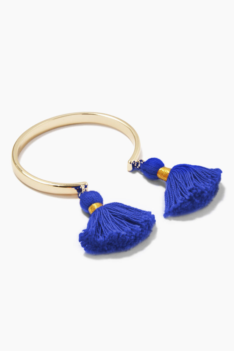 LACEY RYAN Royal Blue & Gold Tassel Bangles Jewelry | Royal Blue & Gold | Lacey Ryan Royal Blue & Gold Tassel Bangles. Features:  Beautiful bangle Made from brass Plated in gold Handmade royal blue tassel Front View