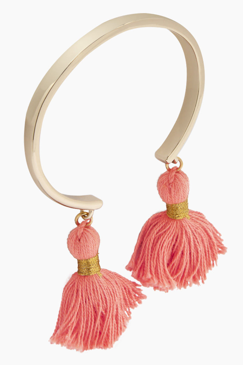 LACEY RYAN Tassel Bangles - Coral & Gold Jewelry | Coral & Gold| Lacey Ryan Tassel Bangles - Coral & Gold. Features:  Beautiful bangle Made from brass Plated in gold Handmade coral silk tassels Front View