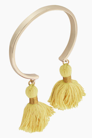LACEY RYAN Yellow & Gold Tassel Bangles Jewelry | Yellow & Gold | Lacey Ryan Yellow & Gold Tassel Bangles. Features:  Beautiful bangle Made from brass Plated in gold Handmade yellow silk tassels Front View