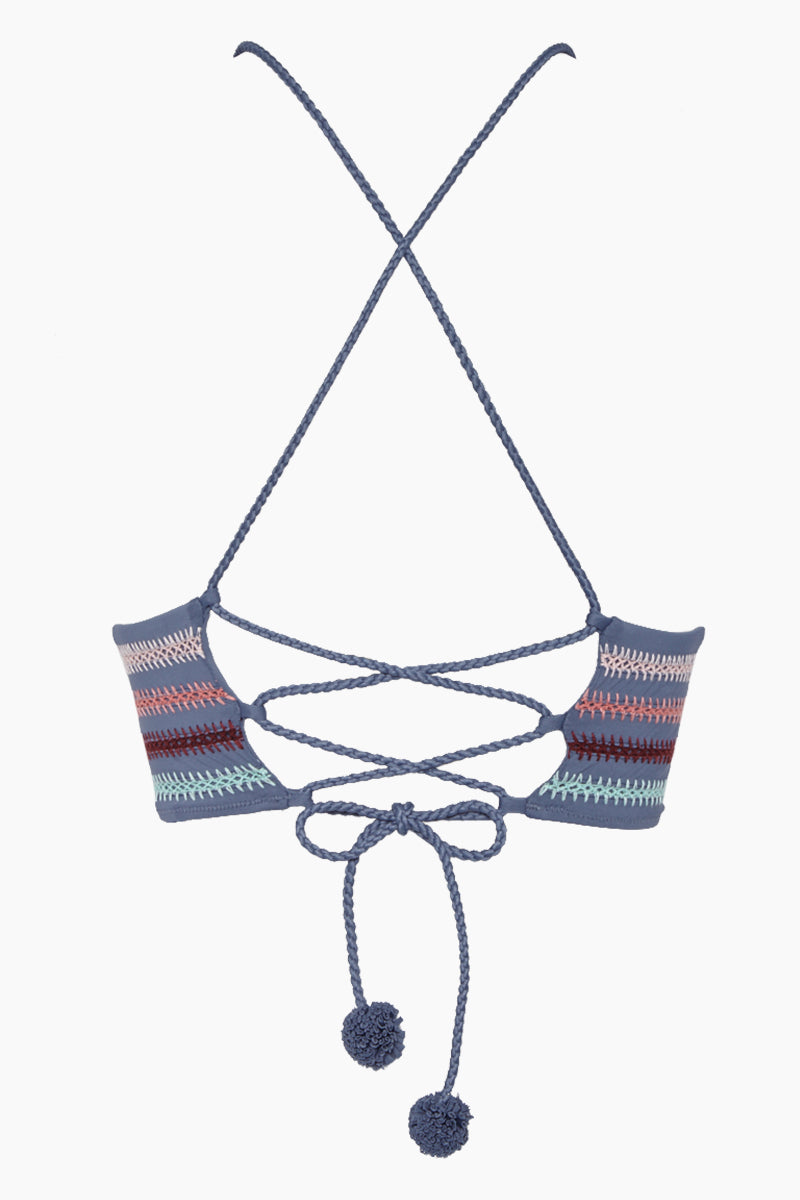 DOLCE VITA Kokomo Embroidered Triangle Bikini Top - Pigeon Bikini Top   Pigeon  Dolce Vita Kokomo Embroidered Triangle Bikini Top - Pigeon. Features:  Triangle top with embroidered underbust band Adjustable lace-up back Pom pom rope ties 82% Nylon, 18% Spandex Back View