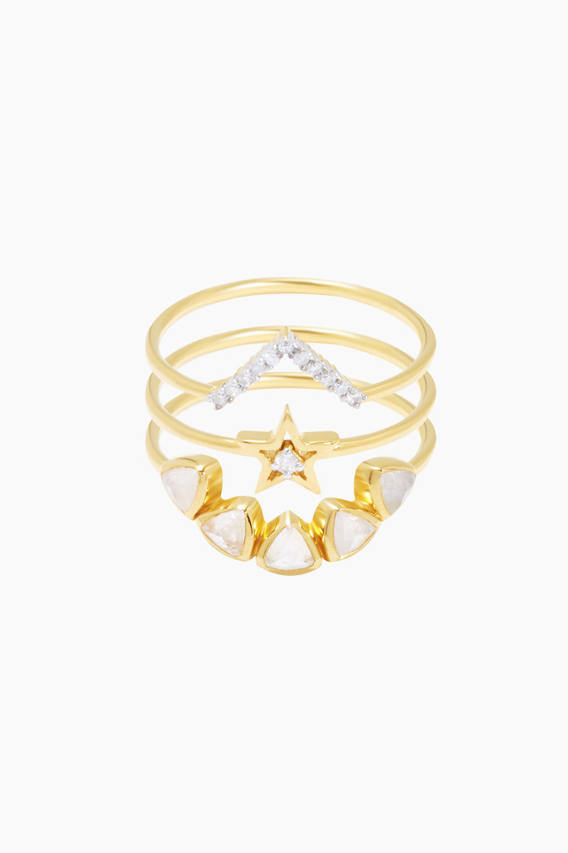 CARRIE ELIZABETH 14K Gold Vermeil Big Bang Ring - Gold/ Moonstone/ Diamond Jewelry | Gold/ Moonstone/ Diamond| Carrie Elizabeth 14K Gold Vermeil Big Bang Ring - Gold/ Moonstone/ Diamond An arc of rose cut semi-precious moonstone sits beautifully above a sparkling 5-point star with a single cut white diamond and a V shaped shooting star set with 11 single cut white diamonds totaling 0.3 carats. Made from a sterling silver base metal, and is then coated with really thick gold plate Handmade in India Front View