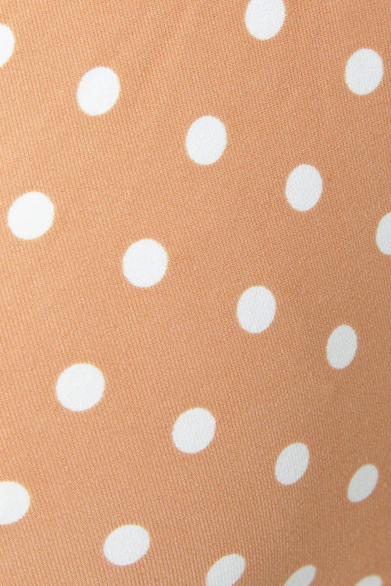 ONIA Allie Underwire Demi Cup Bikini Top - Nude Polka Dot Bikini Top | Nude Polka Dot| Onia Allie Bikini Top - Nude Polka Dot Underwire demi cups with darting at center lift and shape your bust. Adjustable spaghetti straps with winged front fabric that can be scrunched or fanned out to create true cap sleeves. Engraved back clasp closure lends a streamlined finish. Close View