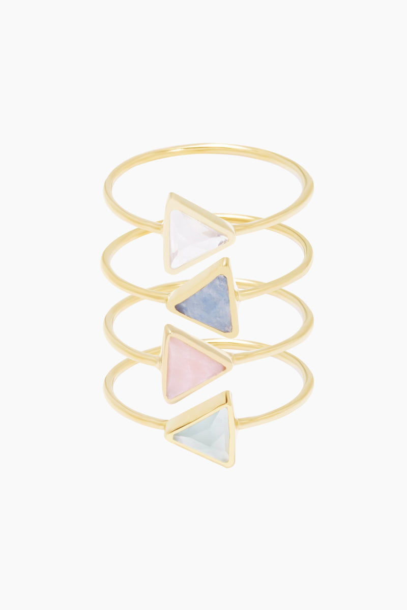 CARRIE ELIZABETH 14K Gold Vermeil Set Of 4 Stacking Rings - Moonstone/Lilac Quartz/Rose Quartz/Aquamarine Jewelry | Moonstone/ Lilac Quartz/ Rose Quartz/Aquamarine|Carrie Elizabeth 14K Gold Vermeil Set Of Four Rings - Moonstone/ Lilac Quartz/ Rose Quartz/Aquamarine 14k Gold Vermeil ring is set with a hand cut triangle shaped natural semi-precious stone measuring 4mm. 4 stones include super translucent Moonstone, Lilac Quartz, Aquamarine and Rose Quartz Handmade in India Front View