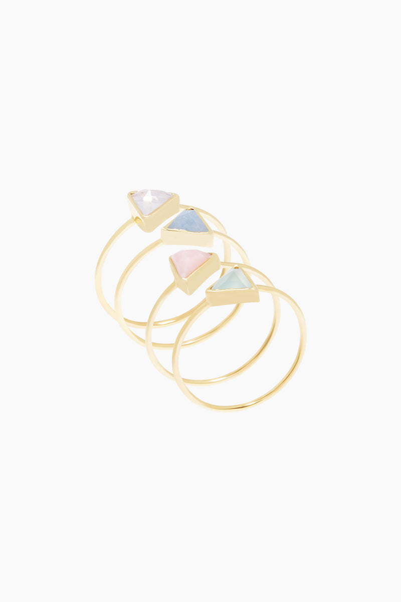 CARRIE ELIZABETH 14K Gold Vermeil Set Of 4 Stacking Rings - Moonstone/Lilac Quartz/Rose Quartz/Aquamarine Jewelry | Moonstone/ Lilac Quartz/ Rose Quartz/Aquamarine|Carrie Elizabeth 14K Gold Vermeil Set Of Four Rings - Moonstone/ Lilac Quartz/ Rose Quartz/Aquamarine 14k Gold Vermeil ring is set with a hand cut triangle shaped natural semi-precious stone measuring 4mm. 4 stones include super translucent Moonstone, Lilac Quartz, Aquamarine and Rose Quartz Handmade in India Side View