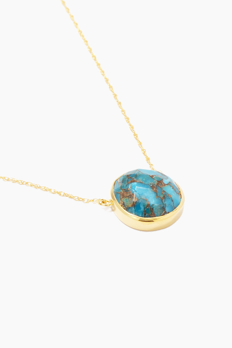 CARRIE ELIZABETH 14K Gold Vermeil Turquoise Stone Pendant Necklace Jewelry | Gold/ Turquoise| Carrie Elizabeth 14K Gold Vermeil Semi Precious Stone Pendant - Gold/ Turquoise Features:  Organic shaped Turquoise stone set in 14k Gold Vermeil  Gold Vermeil chain  Lobster claw closure Handmade in India  Side View