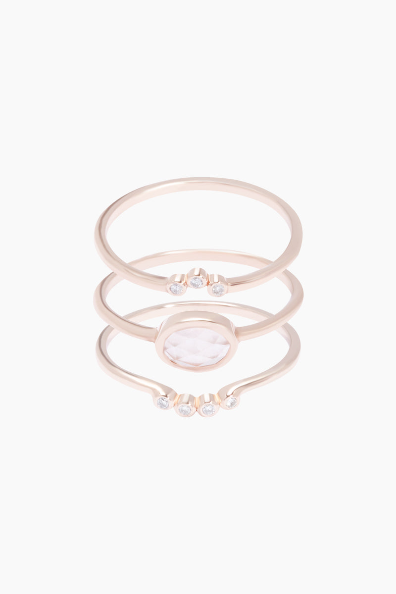 CARRIE ELIZABETH 14K Rose Gold Vermeil Cloud 9 Diamond & Rose Quartz Set of 3 Stacking Rings Jewelry | Rose Gold/ Rose Quartz|Carrie Elizabeth 14K Rose Gold Vermeil Cloud 9 Stacking Set - Rose Gold/ Rose Quartz Crafted in beautiful rose gold vermeil, these three delicate bands stack together  Each band is elegantly set with stunning semi-precious rose quartz stones & diamonds Handmade in India Front View