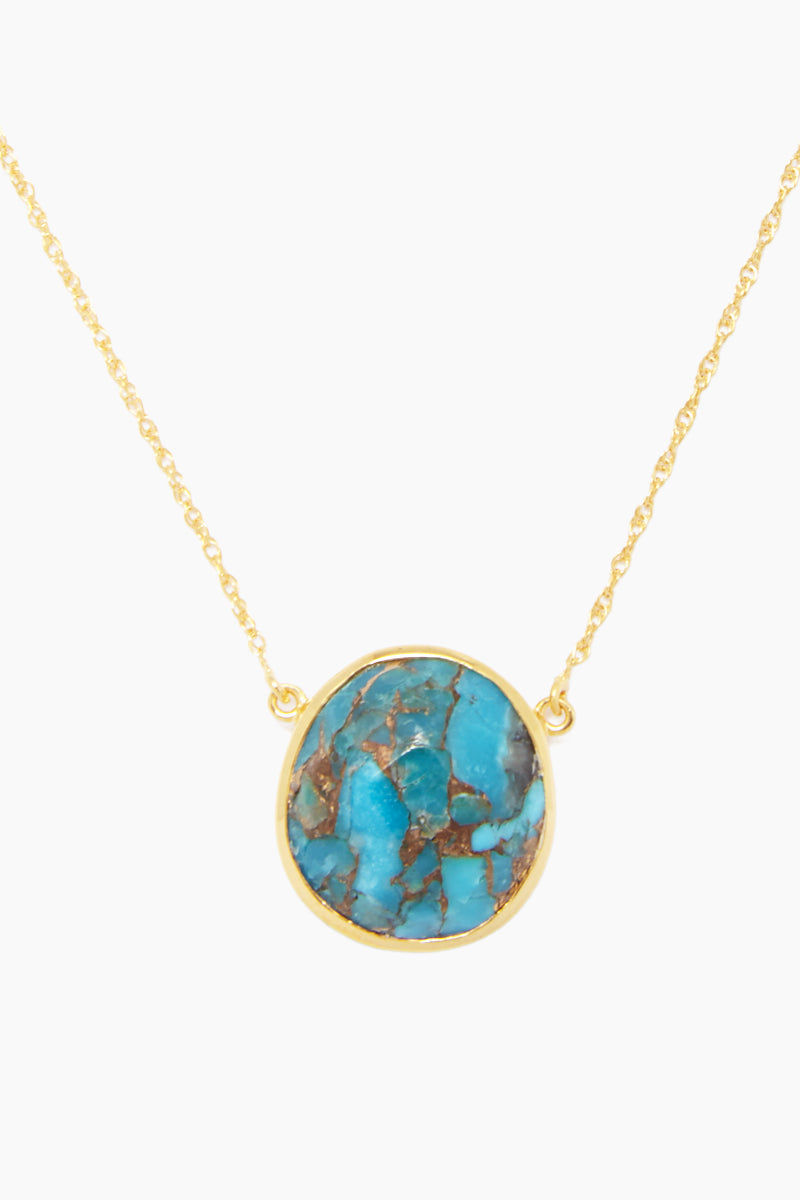 CARRIE ELIZABETH 14K Gold Vermeil Turquoise Stone Pendant Necklace Jewelry | Gold/ Turquoise| Carrie Elizabeth 14K Gold Vermeil Semi Precious Stone Pendant - Gold/ Turquoise Features:  Organic shaped Turquoise stone set in 14k Gold Vermeil  Gold Vermeil chain  Lobster claw closure Handmade in India  Front View