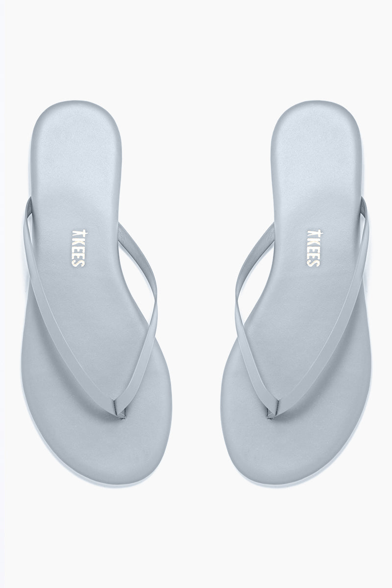 TKEES Solids Sandals - Dolphin Tail Sandals | Dolphin Tail| Tkees Solids Sandals - Dolphin Tail Classic Flip Flops in Pastel Blue Color Made in Brazil    Material:  Leather Upper Leather Insole Rubber Outsole Front View