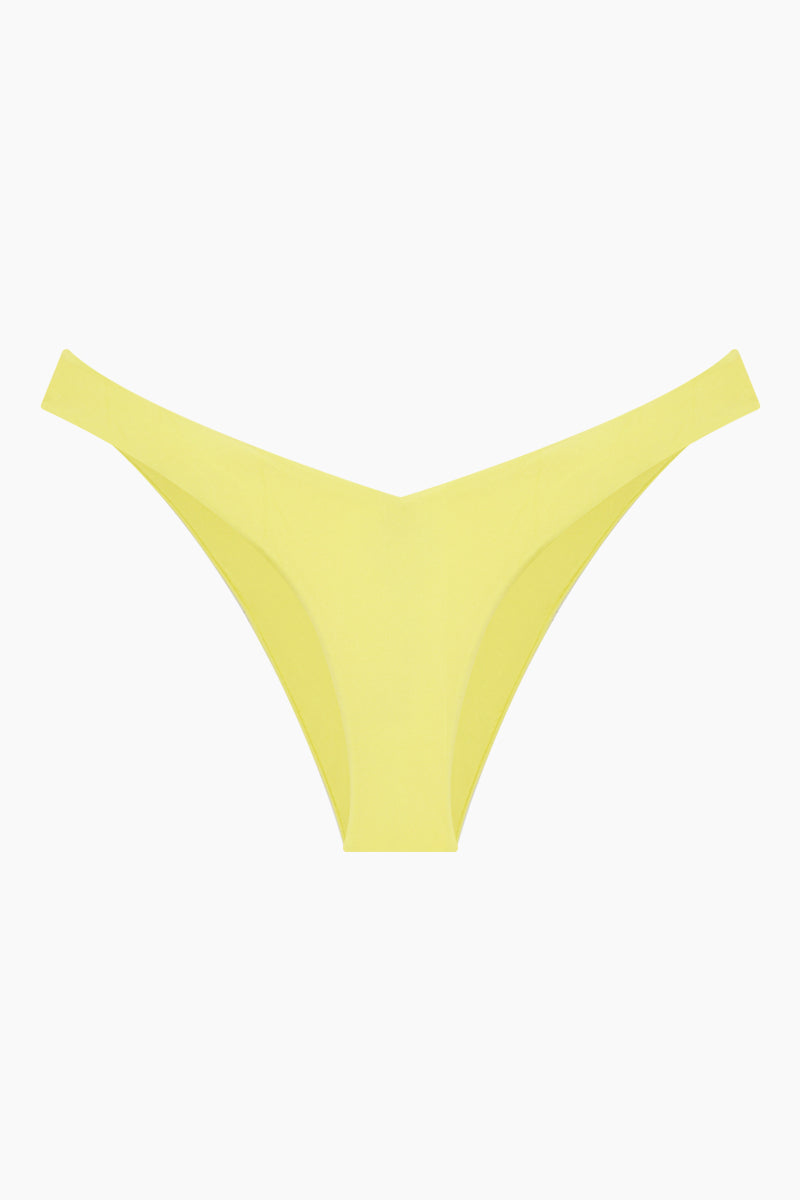 MONICA HANSEN BEACHWEAR Babe Watch V Bikini Bottom - Yellow Bikini Bottom | Yellow| Monica Hansen Beachwear Babe Watch V Bikini Bottom - Yellow Waist cut down in a V shape in front and in back Sides can be worn low rise or mid rise High cut leg  Cheeky coverage Italian fabric 85% Nylon 15% Elastane Manufactured in Italy Hand wash cold.  Dry Flat Front View