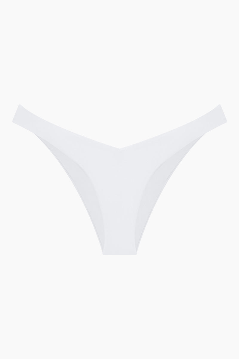 MONICA HANSEN BEACHWEAR Babe Watch V Bikini Bottom - White Bikini Bottom | White| Monica Hansen Beachwear Babe Watch V Bikini Bottom - White Waist cut down in a V shape in front and in back Sides can be worn low rise or mid rise High cut leg  Cheeky coverage Italian fabric 85% Nylon 15% Elastane Manufactured in Italy Hand wash cold.  Dry Flat Front View