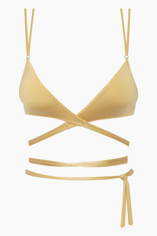 MONICA HANSEN BEACHWEAR That 90's Vibe Wrap Bikini Top - Gold Bikini Top | Gold| Monica Hansen That 90's Vibe Wrap Bikini Top - Gold Features:  Convertible wrap style bikini top V neckline  Double set of thin shoulder straps  Double fabric on the inside instead of lining Italian fabric 85% Nylon 15% Elastane Front View