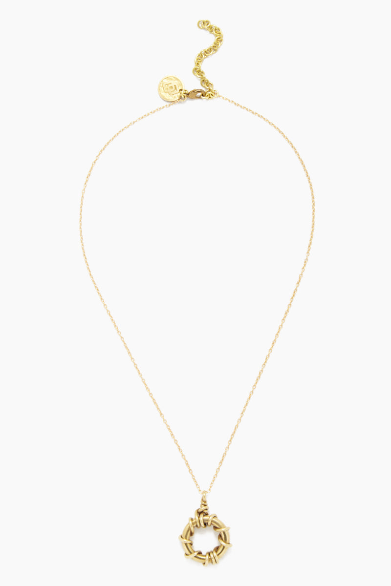SOKO JEWELRY Kamba Delicate Necklace - Brass Jewelry | Brass| Soko Jewelry Kamba Delicate Necklace - Brass Features: Circular necklace pendant  Lobster clasp closure  Recycled polished brass Handcrafted in Kenya Front View
