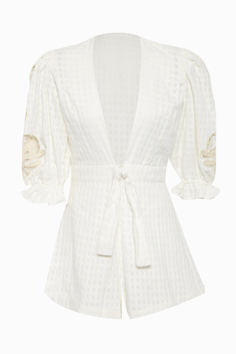 ADRIANA DEGREAS Embroidery Romper - Off White Romper | Off White| Adriana Degreas Embroidery Romper - Off White  Long sleeve romper Plunging neckline Embroidered long sleeve detail  Front tie detail  Front View