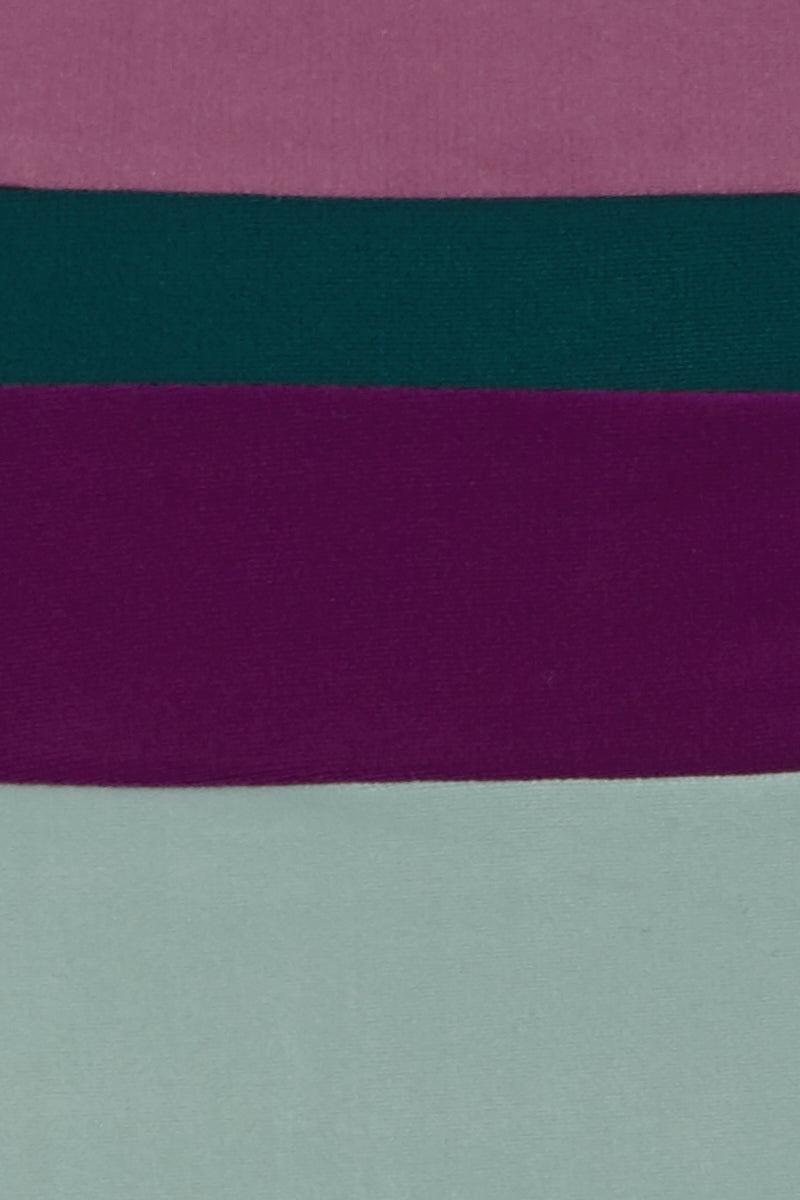ADRIANA DEGREAS Hot High Waist Bikini Bottom - Mint/Green/Purple/Lilac Color Block Bikini Bottom | Mint/Green/Purple/Lilac Color Block| Adriana Degreas Hot Color Block High Waist Bikini Bottom - Light Blue/Green/Purple/Lilac. Features:  High-rise bikini bottom Medium coverage Main: 84% polyamide, 16% spandex. Front View