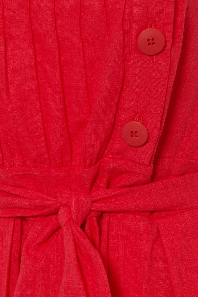 CLUBE BOSSA Ascari Button Front Jumpsuit - Pepper Red Jumpsuit | Pepper Red| Clube Bossa Ascari Jumpsuit - Pepper Red Jumpsuit  Front side button detail  Waist tie belt detail Thick shoulder straps Wide pant leg  Front View