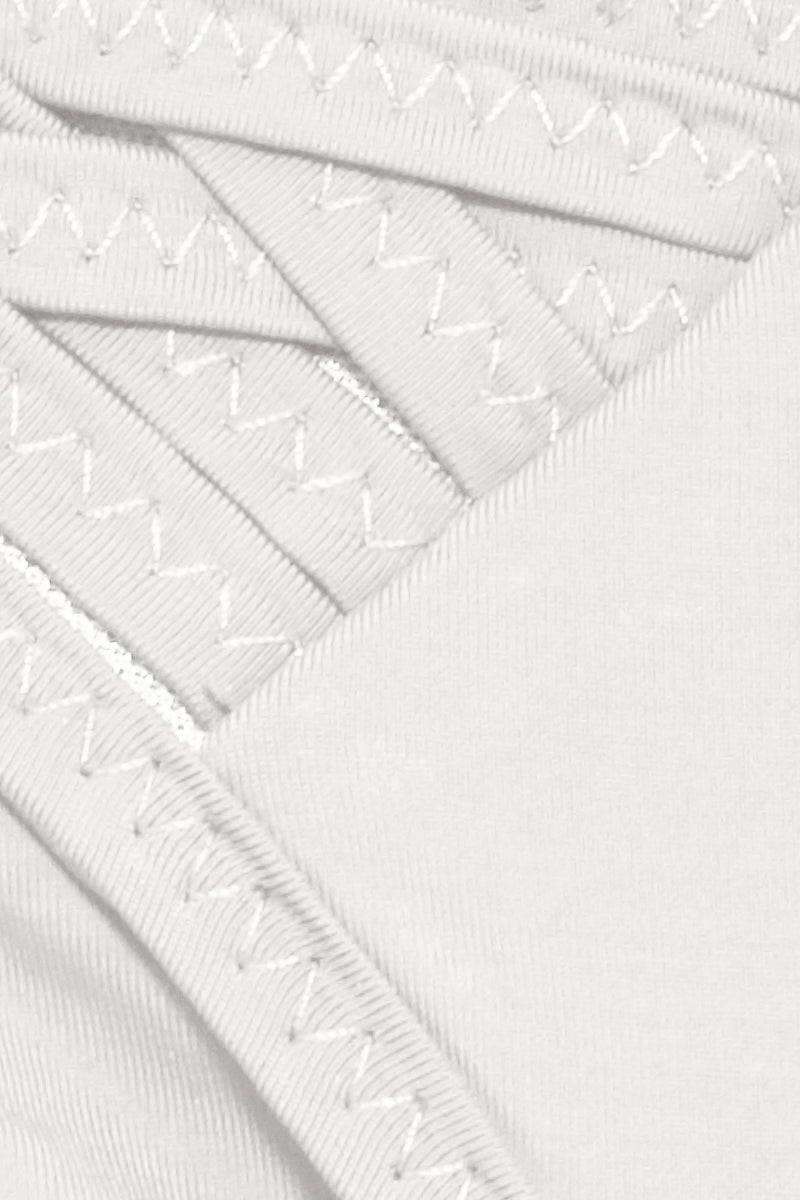 CLUBE BOSSA Lauder Weaving Tie Side Bikini Bottom - Off White Bikini Bottom   Off White  Clube Bossa Lauder Weaving Tie Side Bikini Bottom - Off White Low rise  Tie side  Weaving detail Cheeky coverage Front View