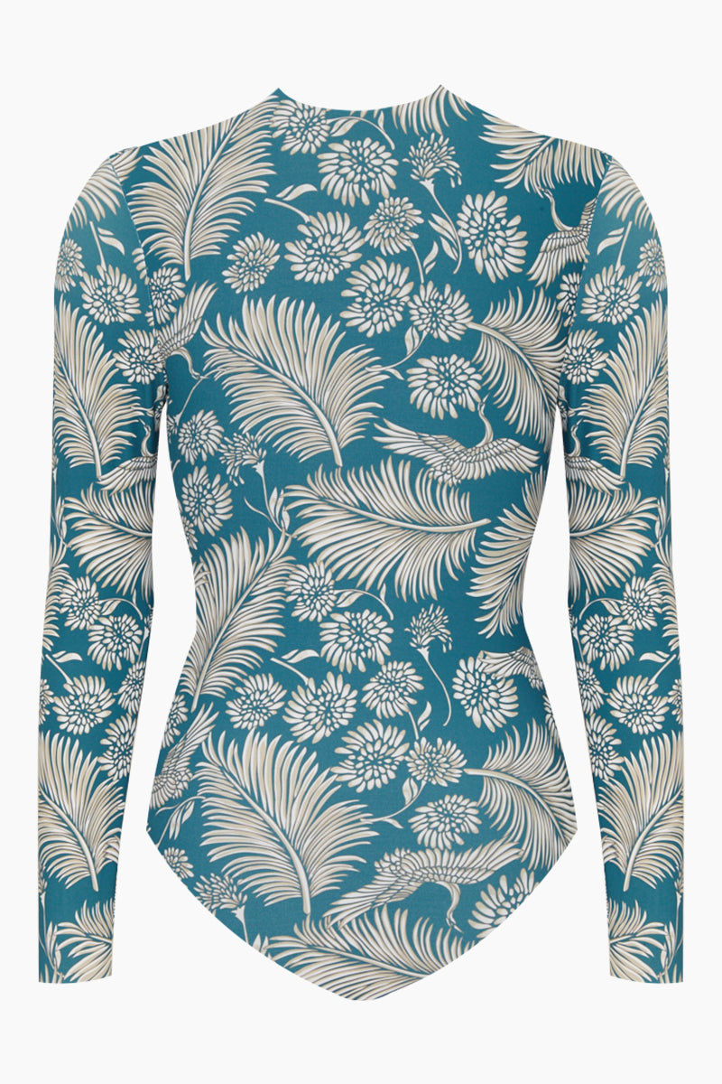 AMUSE SOCIETY Savanhah Long Sleeve Rashguard Bodysuit - Caribbean Blue Tropical Print One Piece | Caribbean Blue Tropical Print| Amuse Society Savanhah Long Sleeve Rashguard Bodysuit - Caribbean Blue Tropical Print Blue tropical print one piece High neckline  Long sleeve  Back zipper closure  Cheeky - moderate coverage Front View