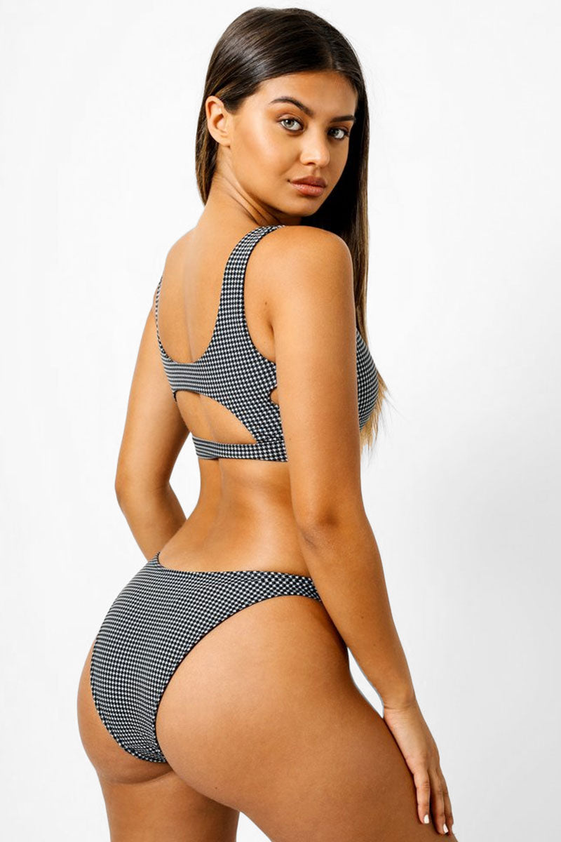 KAOHS Abby Cut Out Bikini Top - Black & White Houndstooth Print Bikini Top |  Black & White Houndstooth Print| Kaohs Abby Cut Out Bikini Top - Black & White Houndstooth Print Features:   Scoop neckline  Front knot detail  Front, side, and back cut out detail Thick bra band  Back View