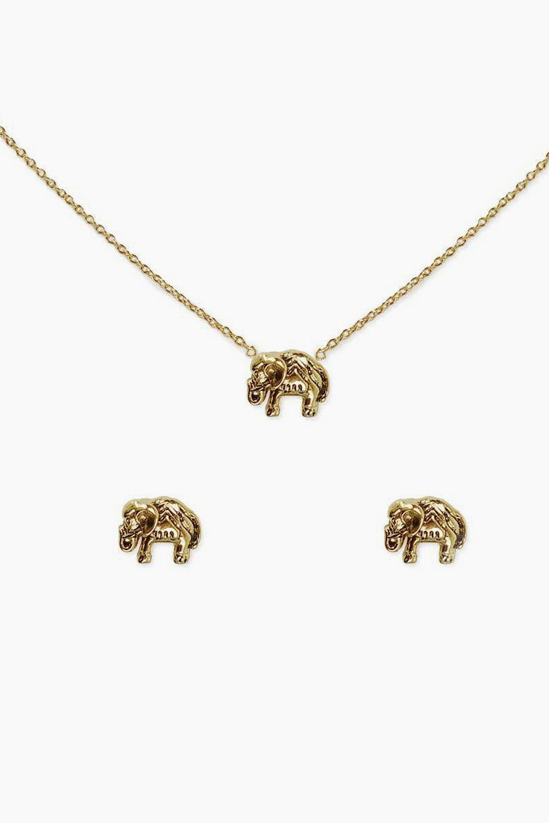"KITSCH Karma Necklace & Earring Set - Gold Jewelry | Gold| Kitsch Karma Necklace & Earring Set - Gold  Delicate elephant charm necklace with thin chain. 14K gold-dipped brass. Wear the symbol of luck, fortune, and protection around your neck or give as a gift to your spiritual special someone. The medium-length 16"" chain has a 1"" extender. Front View"